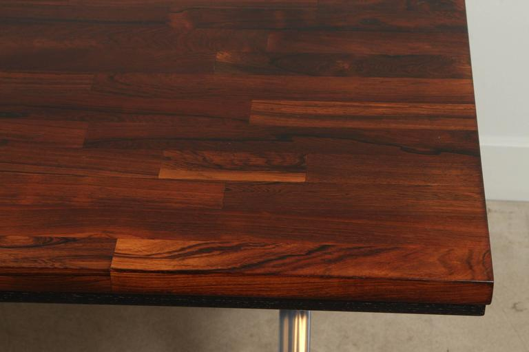 Solid rosewood desk with stainless base by Jules Heumann for Metropolitan Group.