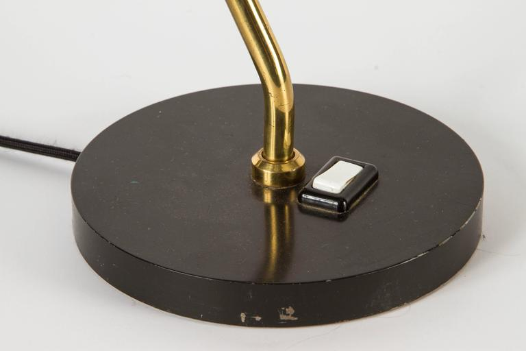 Jean Boris Lacroix table lamp in black and brass.