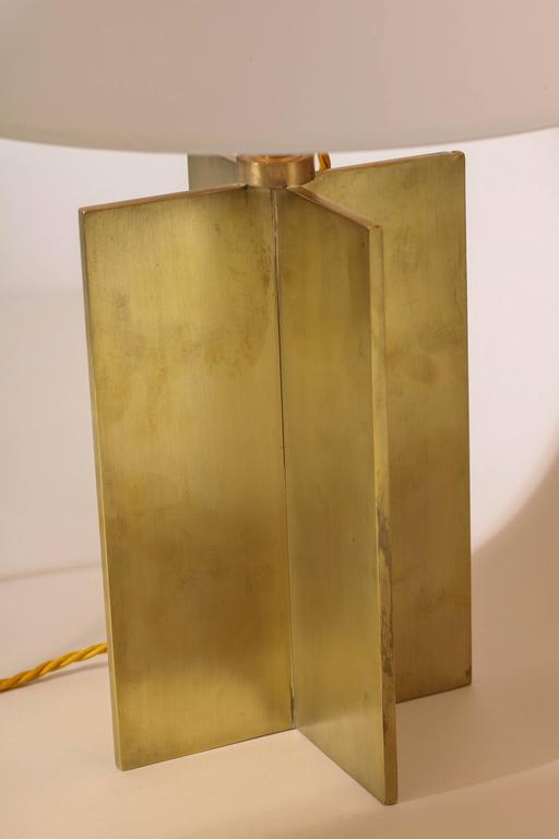 With four perpendicular brass rectangles radiating from a central attachment. Paper shades. Rewired to American standard. Good working condition. Produced by Comte, Buenos Aires, Argentina With a certificate of authenticity from the Comite