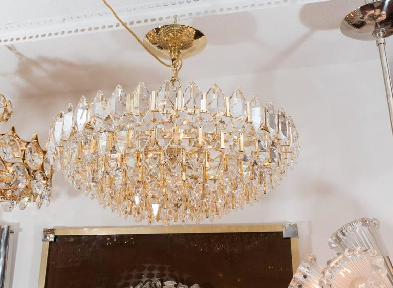Mid-Century Modern Tiered Brass and Crystal Chandelier For Sale