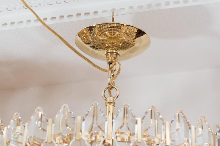 Austrian Tiered Brass and Crystal Chandelier For Sale
