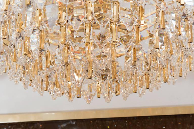 Late 20th Century Tiered Brass and Crystal Chandelier For Sale