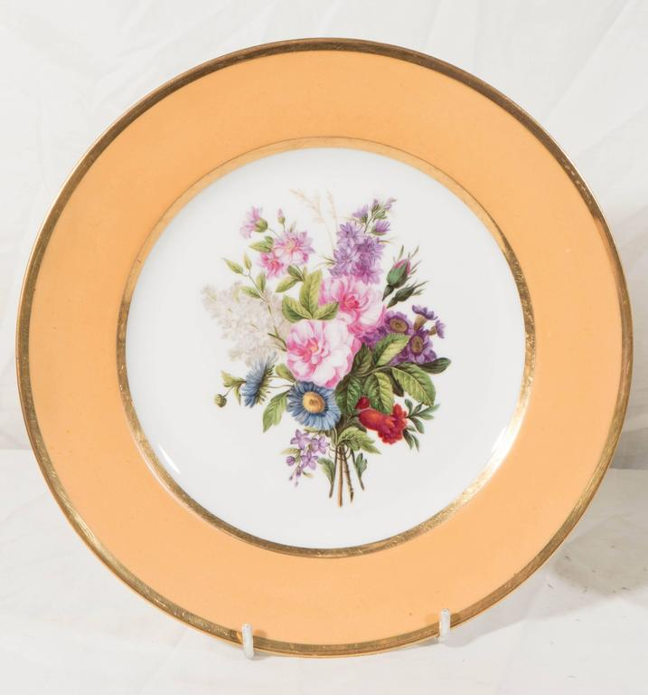 French Pair Sèvres Dishes Hand-Painted with Bouquets of Flowers and an Apricot Border For Sale