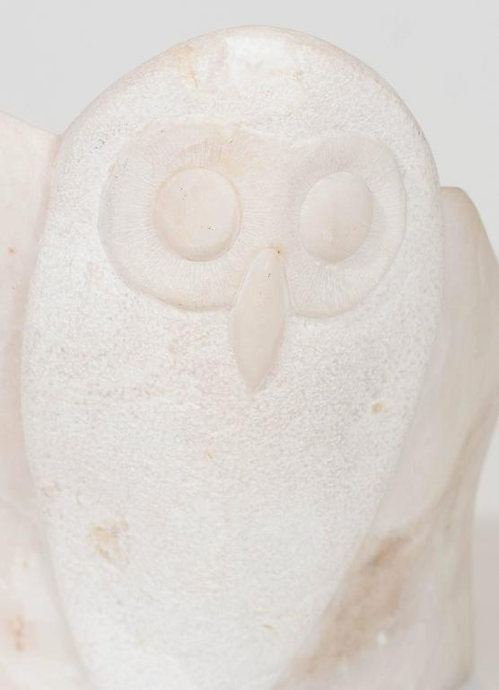 This modernist carved marble sculpture was produced by an unknown artist, circa 1980s, in the form of an owl preparing to take flight. Markings include artist's signature and date [Mena, 85], etched into the base of the piece. Very good condition,