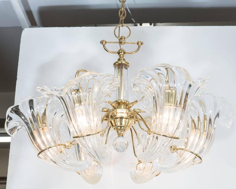 A vintage six-light Italian chandelier, designed circa 1970s by Franco Luce, the frame in beautifully polished brass, with crystal ball finial, and clear Murano glass cornucopia inserts as shades. Wiring and sockets to US standard, requires six