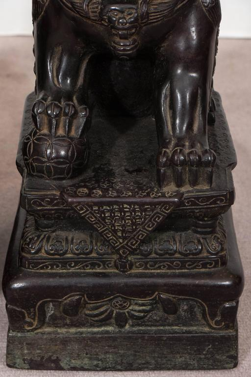 Pair Of Chinese Foo Dogs On Pedestals In Bronze At 1stdibs
