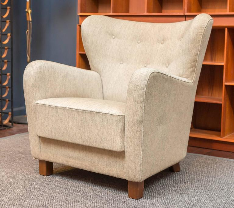 Rare and important design by Thorald Madsens Jr. for Snedkeri, Copenhagen.  A robust and masculine wing chair with an inviting deep comfortable seat. Excellent build quality in very good original condition with manufacturer's metal tag.  Acquired