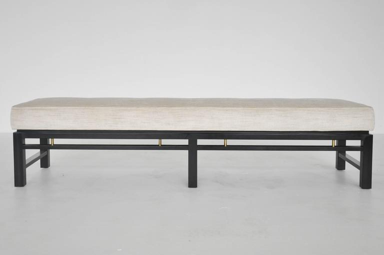 Bench by Edward Wormley for Dunbar. Ebonized mahogany frame with brass details. Newly upholstered.