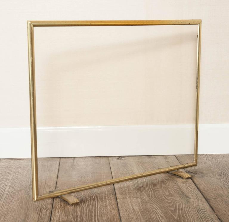 hollywood regency brass and glass fire screen is no longer available