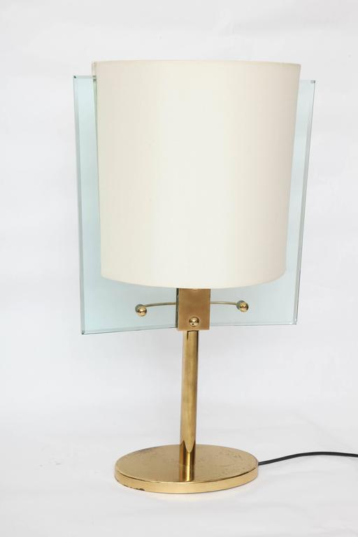 A Italian glass and brass table lamp by Fontana Arte designed by Nathalie Grenon.