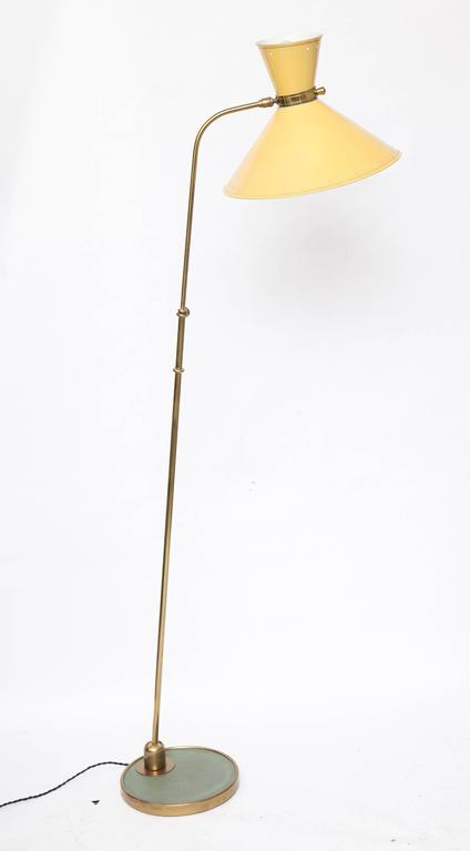 A 1950s French articulated floor lamp by Jean Boris Lacroix.