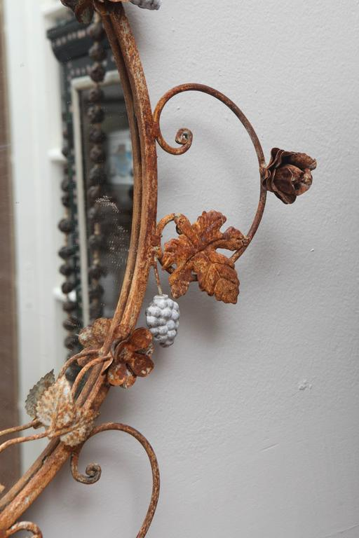 Vintage rusted mirror. Hand wrought iron.  Probably not terribly old but great look.  Round mirror inset is new.  Some remnants of white paint and quite rusted.