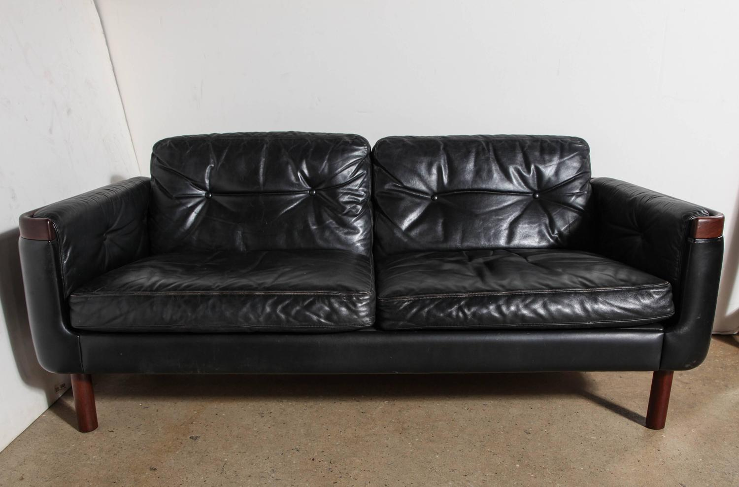 scandinavian modern black leather and rosewood loveseat at