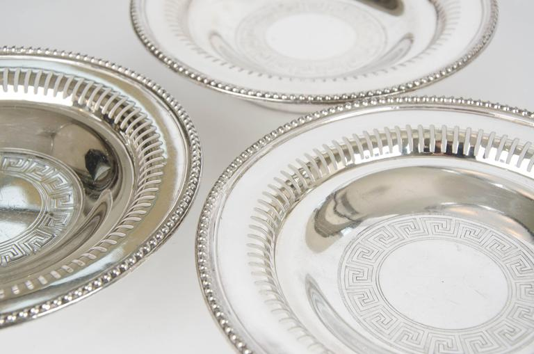Set of three silver plate wine coasters, circa 1875. Beautifuuly adorned with a geometric pattern on the base inside. Great for dinner parties where more than one bottle has been opened.  Please contact us for shipping prices.