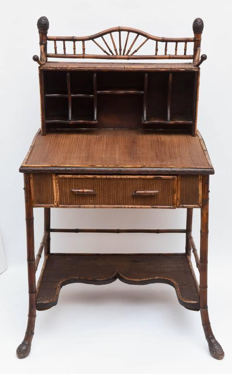 """Wonderful form punctuated with dramatic """"root"""" appointments. The piece features a nice upper gallery for books and a large serpentine bottom shelf and a favorable slant top."""