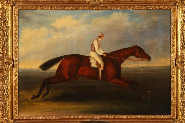 Henry Alken was a prolific artist and is desirable among collectors of equine art. Image of the horse Sorcery, who won an important race in 1811; a jockey riding a running horse in a pasture; with a blue and cloudy sky, within a carved gilt frame.