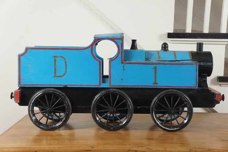 This is part of a much larger collection of children's toys at painted porch. We particularly love toy trains and this blue train makes quite a statement for a country accessory. Done in blue and red with six original wheels.