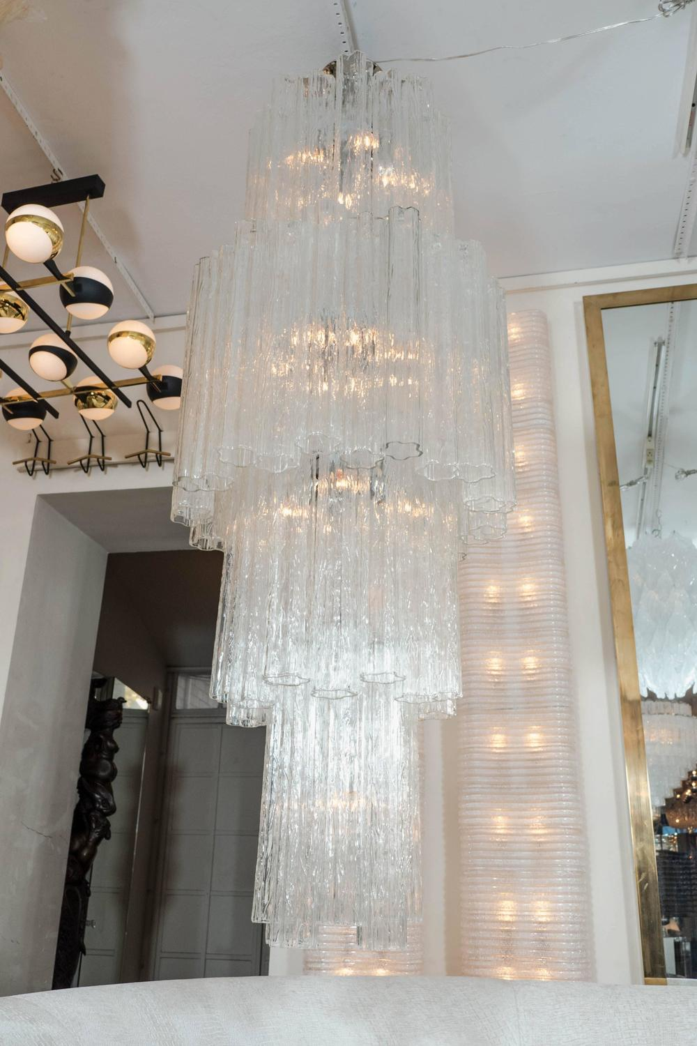 Long Vertical Multitiered Chandelier With Tubular Elements