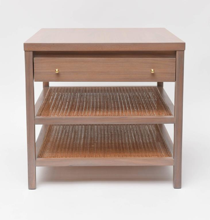 Small side table by Paul McCobb for Calvin. We've re-finished the walnut frame in our signature