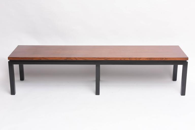 This beautiful Mid-Century piece in very much in the style of pieces designed by the iconic furniture designer Harvey Probber and dates to the late 1940s-1950s. The base is finished in black and the top is walnut. With its clean lines this piece can