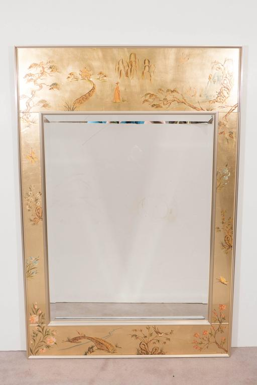 A vintage chinoiserie style wall mirror, produced by Labarge, circa 1970s, inset within a reverse hand-painted églomisé frame, decorated with birds, butterflies and varied floral designs, as well as Asian motifs and architectural elements,