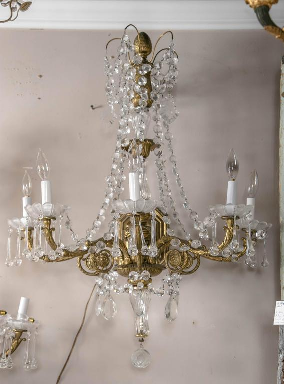 A fabulous French pair of five-light gilt bronze and crystal sconces. Just magnificent.