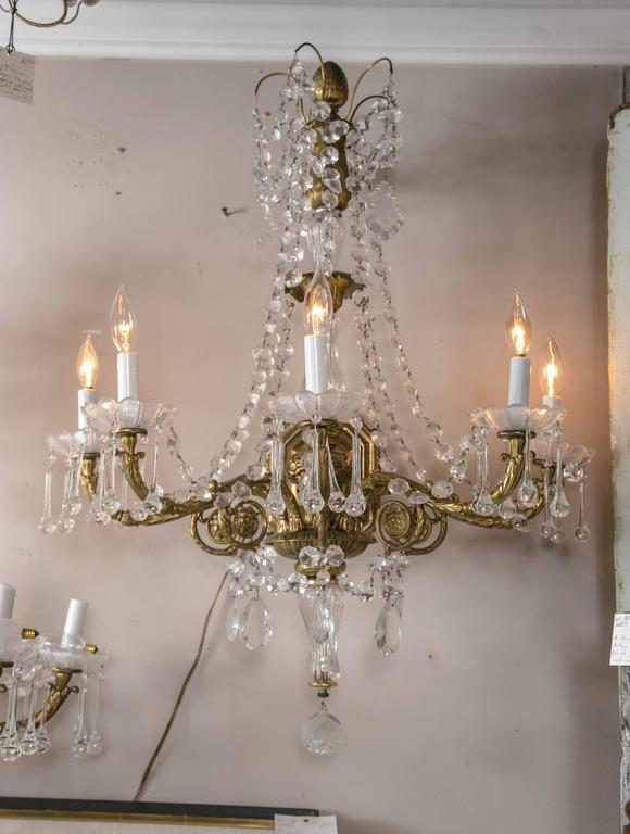 20th Century Pair of French Gilt Bronze and Crystal Sconces For Sale