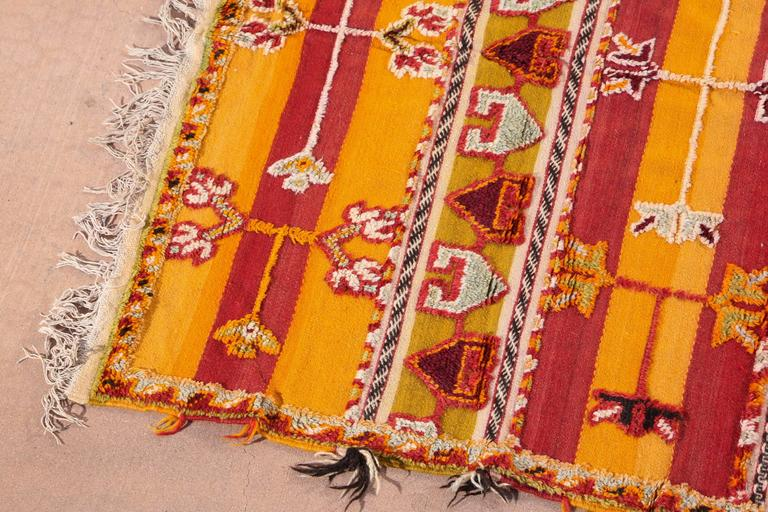 Moroccan vintage tribal rug, handwoven by the Berber women of Morocco. Mixed of flat and pile weaving work. Geometric African designs, orange, red, black and ivory colors. Great African Folk Art collector carpet.