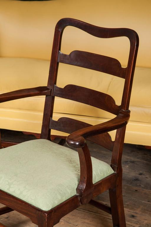 Set of eight George II mahogany dining chairs. Including two elbow chairs, English/Irish, circa 1750.