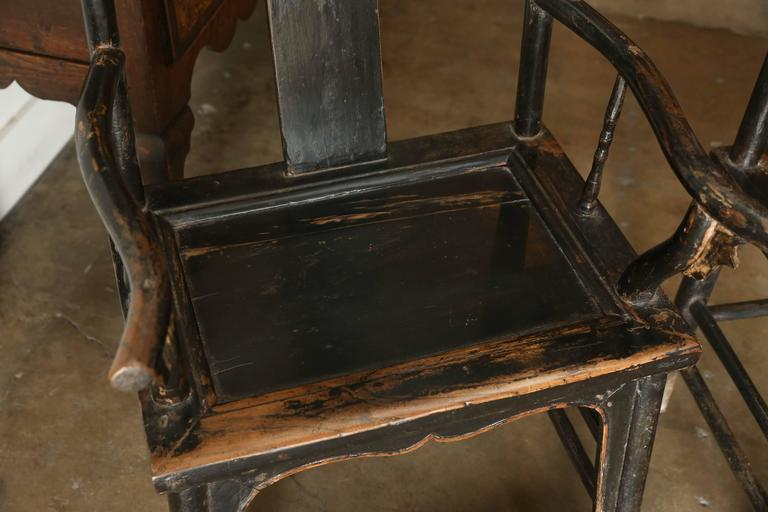 Pair of yoke back elm armchairs, circa 1880-1900, China.