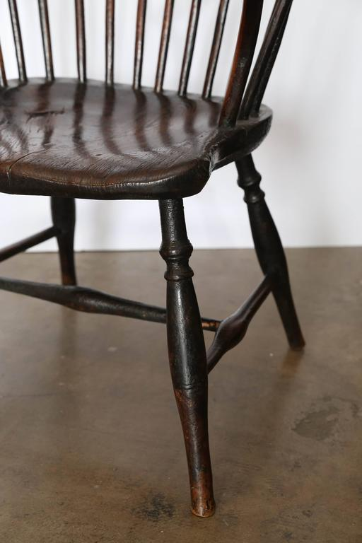 19th century windsor chair, circa 1840. Beautifully worn seat and arms.