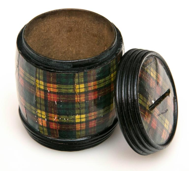 In the mid-1800s tartan became the most popular decoration for souvenirs of Scotland and the box makers of Mauchline soon invented machines to rule the multi-colored clan tartans with many traditional plaid patterns. Soon, new machines were able to