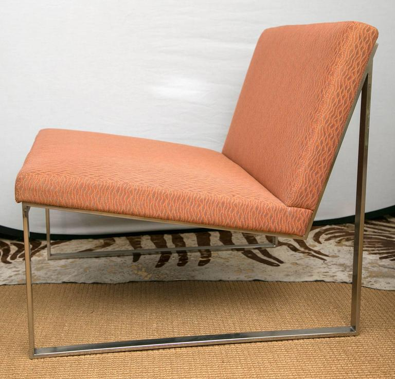 A pair of lounge chairs designed by Fabien Baron for Bernhardt design. The chairs are a brushed nickel open frame design. Currently upholstered with a custom light orange fabric.