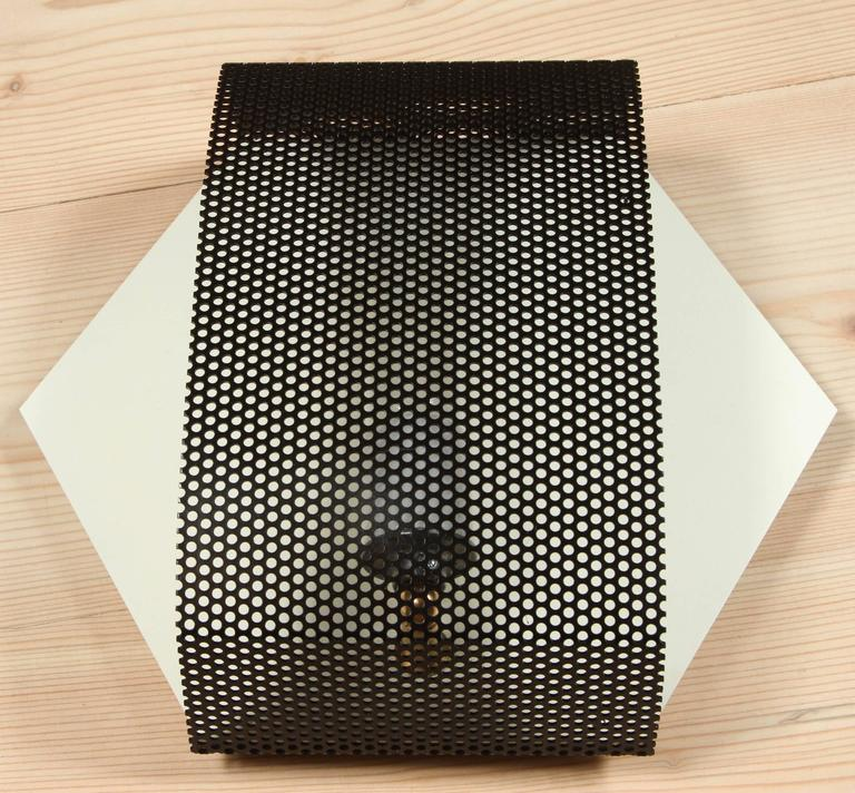 Perforated Hex sconce by Lawson-Fenning.