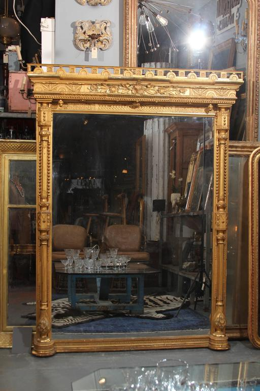 Lovely ornate gilded mirror, Measures: 6 feet.
