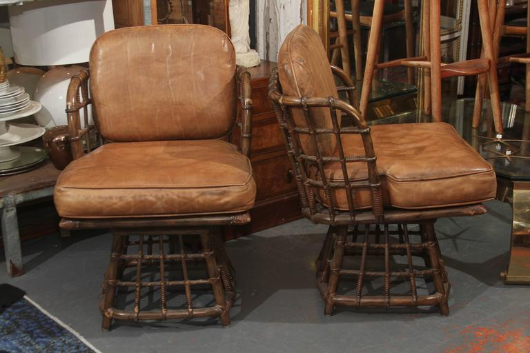 Pair of Mid-Century leather swivel side chairs by Maguire. Leather seat and back, great original condition.