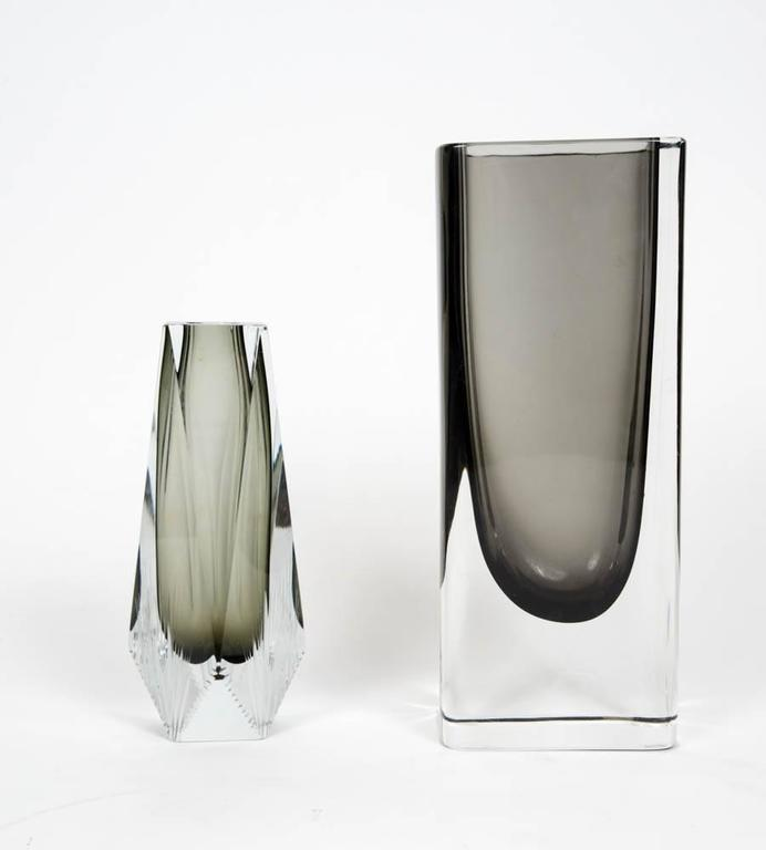 Set of two elegant Sommerso vases. The first one is a tall rectangular piece with round edges while the second one is smaller with cuts decors at the bottom. Both have this very Smokey grey tint in the middle.