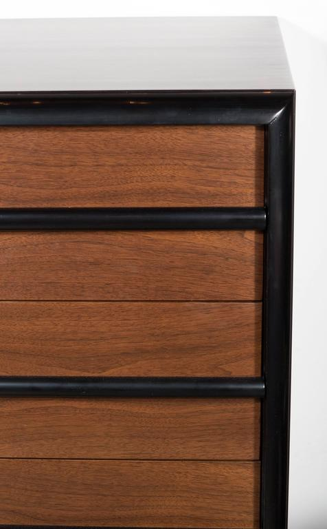This sophisticated Mid-Century Modern four-drawer high chest was realized by T. H. Robsjohn-Gibbings for Widdicomb Company, circa 1950. Robsjohn-Gibbings represents one of the premiere British tastemakers of the 20th century. Along with peers, such