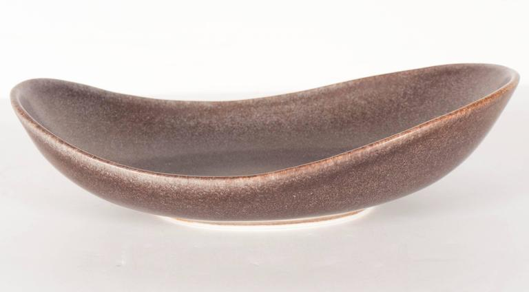 Striking Mid-Century Modernist ovoid bowl by Carl-Harry Stålhane for Rörstrand. A mix of tobacco, grey and burnt terra cotta covers the speckled finish of this piece. Signed on its bottom. This piece is in excellent condition. An incredible