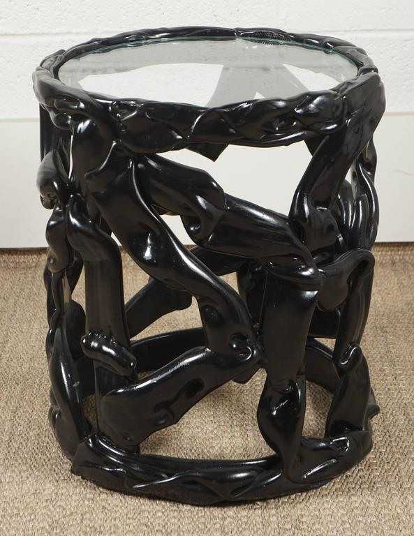 Here is a great Lucite ribbon table in a black lacquered finish with a glass top.