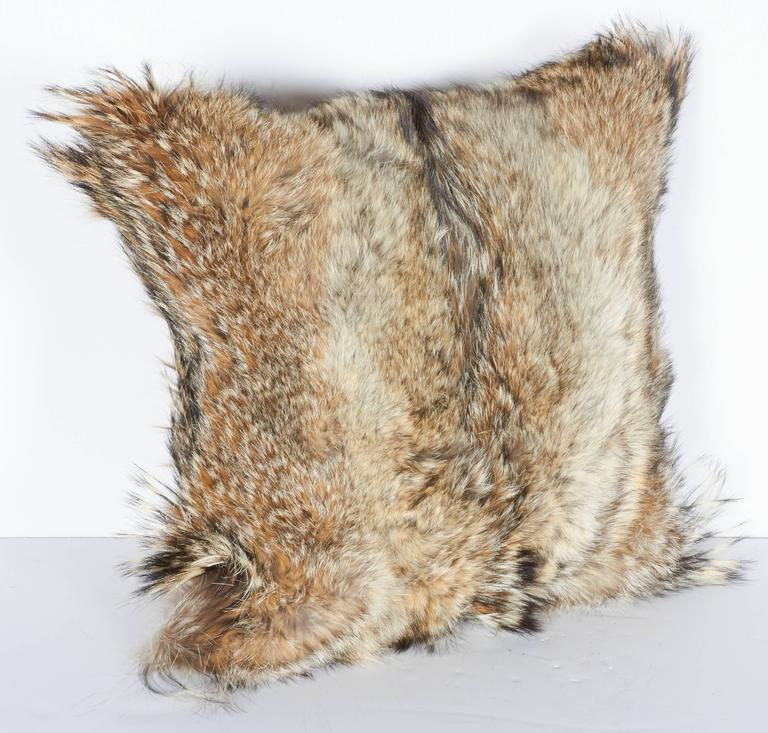 Custom made ultra luxe decorative pillows handcrafted from coyote fur in hues of, tan, camel, ivory and brown, with the occasional black streaks. Each pillow is unique in coloration and texture, and features hand-stitched backing in fine khaki