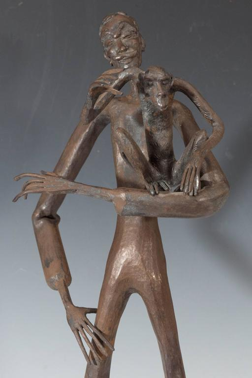 A vintage bronze sculpture, rendered in the Expressionist style, by French sculptor and 'forgeron d'art' (art blacksmith) Jean Marc of Cordes-sur-Ciel, created in 1961, which depicts a lanky man with a monkey on his arm. Very good condition,