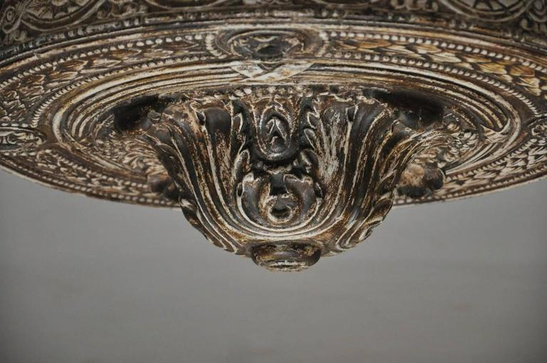 19th century French heavily carved flush mount ceiling plate. Acanthus leaves central decoration surmounted with circular oval flower heads entwined,  egg and dart design at outer rim.