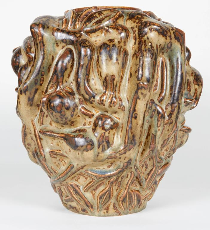 A rare and sizable vase by Royal Copenhagen depicting birds within branches.  Signed and numbered