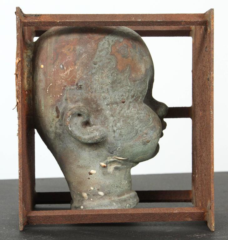 Vintage Bronx toy factory industrial doll head mold. Fantastic patina and layered surface from exposure to various chemicals and high heat during the manufacturing process. Please see all photos. Email with any questions.