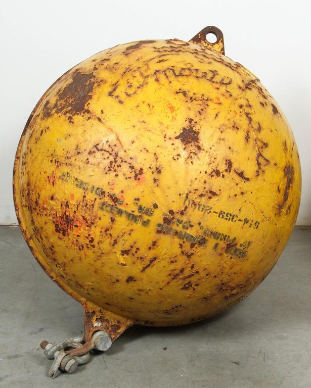 Objects in images appear much bigger in person! Substantial cast iron nautical ocean buoys with fantastic vintage yellow marine paint. Embossed Falmouth, Mass. with a few other embossed markings. Found in the Cape Cod and Martha's Vineyard area.
