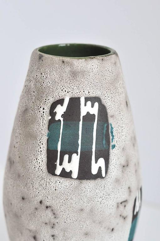 A bold vase with a complicated abstract design and glaze, by one of the leading German ceramic factories of the period, Scheurich Keramik. The decorated panels resemble electrocardiograms perhaps monitoring the