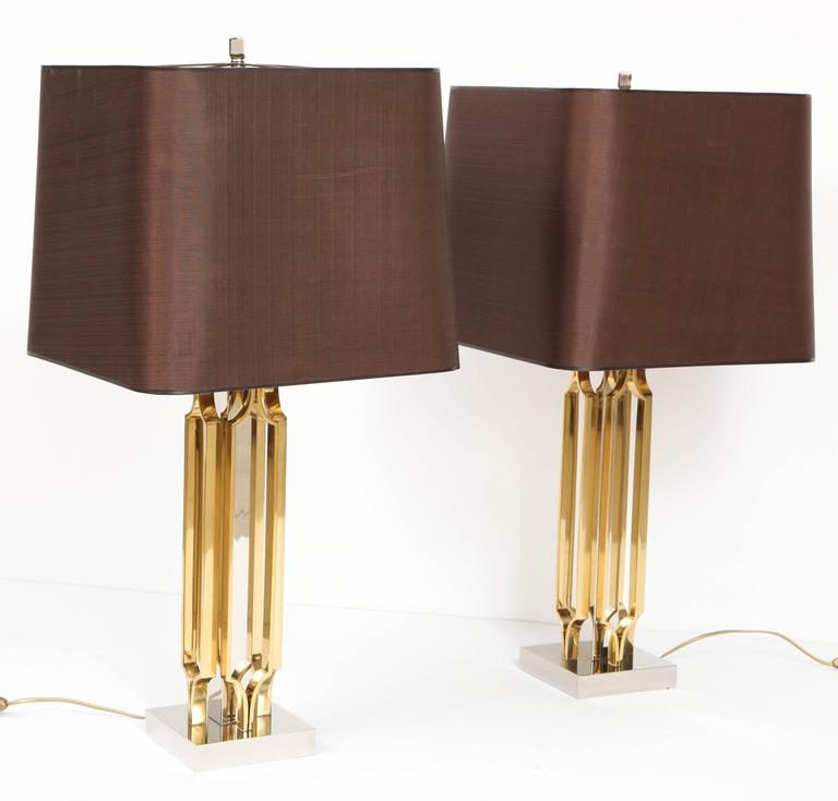 Pair of lamps by Willy Daro, in perfect condition, new rewired and new polish.