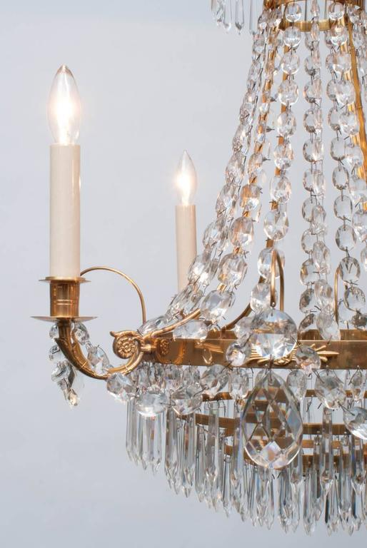 This petite and delicate 4-light chandelier sparkles in the light, excellent Swedish craftsmanship, beautiful patina, includes appropriate chain, hanging hardware and ceiling cap.