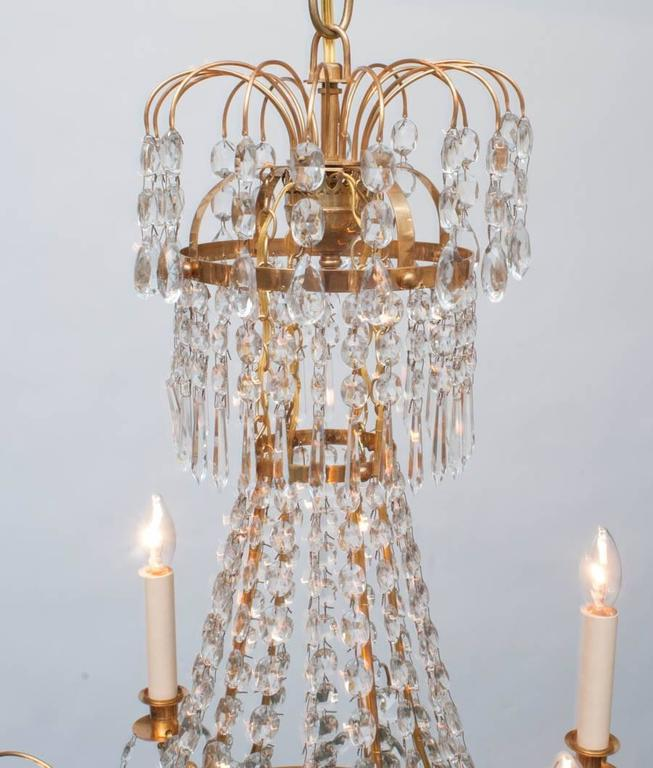 Swedish Neoclassic Style Gilt Brass and Crystal Chandelier, Sweden, circa 1935 For Sale